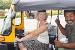 Sarah driving a tuctuc